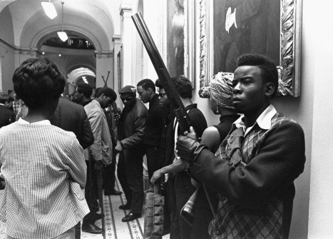 On May 2, 1967, Black Panthers amassed at the Capitol in Sacramento brandishing guns to protest a bill before an Assembly committee restricting the carrying of arms in public. Self-defense was a key part of the Panthers' agenda. This was an early action, a year after their founding.