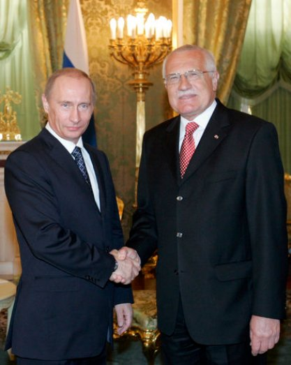 Russian President Vladimir Putin, left, and his Czech counterpart Vaclav Klaus smile as they shake hands during a meeting in Moscow's Kremlin on Friday, April 27, 2007. (AP Photo/ Alexander Zemlianichenko, Pool)