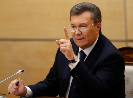 Ukraine's fugitive President Viktor Yanukovych gives a news conference in Rostov-on-Don, a city in southern Russia about 1,000 kilometers (600 miles) from Moscow, Friday, Feb. 28, 2014. Making his first public appearance since fleeing Ukraine, fugitive Ukrainian president Viktor Yanukovych pledged Friday to fight for his country's future but said he will not ask for military assistance. (AP Photo/Pavel Golovkin)