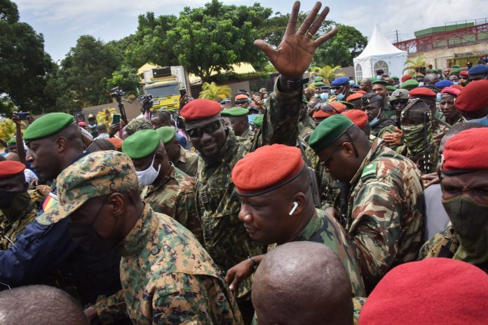 https://i2.wp.com/usercontent.one/wp/washingtonlatest.com/wp-content/uploads/2021/09/Guinea-coup-rattles-iron-ore-and-bauxite-markets-stokes-economic-1392x928.jpg?resize=696%2C464&ssl=1