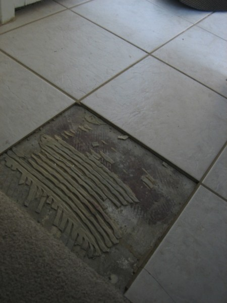 How to Replace Cracked or Damaged Floor Tile   Dengarden Remove all old thinset mortar before setting a new tile