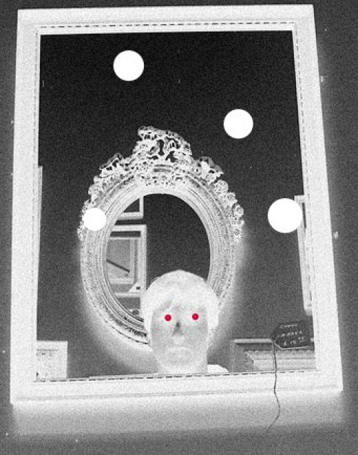 Do strange entities have the ability to use certain mirrors as a portal?