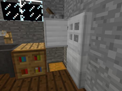 Opening The Fridge Door Reveals An Iron Block And A Chest Built Into Floor