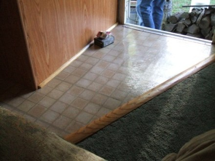 How to Repair or Replace RV   Camper Trailer Floors   AxleAddict Joint between new floor and carpet