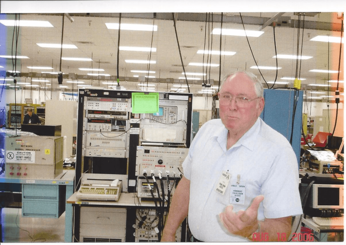 Jim posing in front of a console used for testing and repairing a Shuttle black box known as a Network Signal Processor (NSP) at NASA's Shuttle Logistics Depot located in Cape Canaveral, FL.