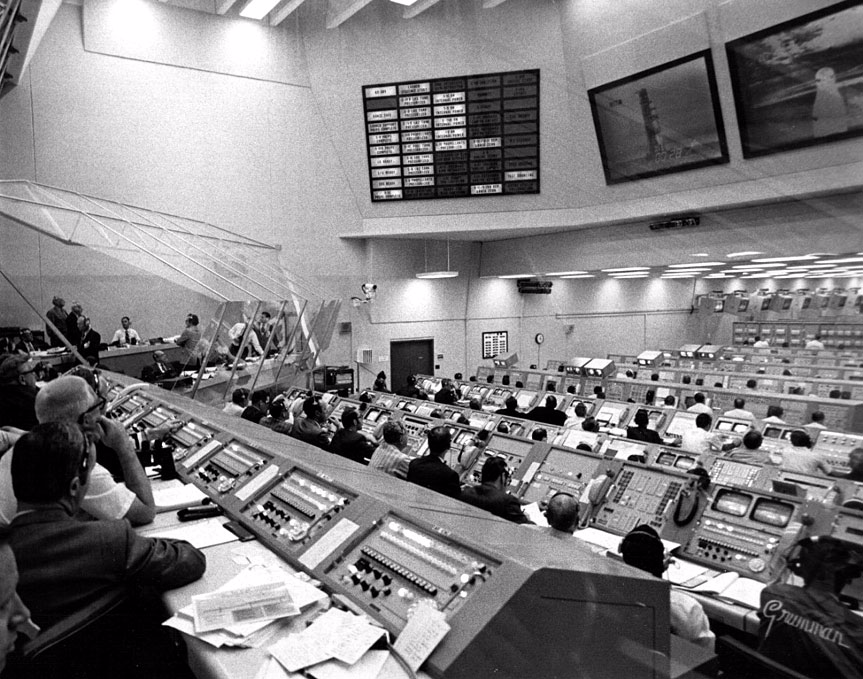 Firing Room 1 of the LCC during an Apollo launch with a different view.