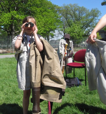 Aracelys Velazquez tries out binoculars at the Endangered Species Day event booth. Credit: USFWS