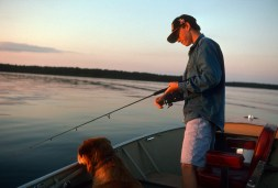 Son Reid and trusty companion Buddy on a lake in northern Minnesota in 1994