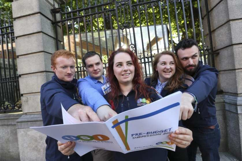 *** NO REPRODUCTION FEE *** DUBLIN : 6/9/2016 : USI Launches Pre-Budget Submission, proposing a minimum €500 reduction in fees, a €140m investment in higher education and a €5m investment in third level mental health counselling.The Union of Students in Ireland will launch its Pre-Budget Submission outside Leinster House at 8:30am on Tuesday the 6th September. The proposals in the submission will include a €500 minimum reduction in fees; a €140 million investment in higher education; reinstating postgraduate grants; and a €5million investment in third-level mental health counselling. USI President, Annie Hoey, said the government needs to match talk of economic recovery with financial investment in third-level education. Pictured (l-r) outside Leinster House, Kildare Street Dublin with USI Pre-Budget Submission were USI members Jack Leahy, Kieran McNulty, USI President Annie Hoey, Siona Cahill and Dan Waugh. Picture Conor McCabe Photography. MEDIA CONTACT : Fiona.omalley@usi.ie or call 0874495695
