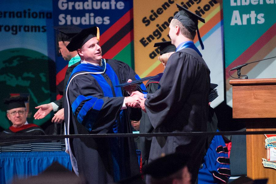 Scott Gordon, Dean of the Pott College of Science, Engineering, and Education, hands a diploma to a student at the 2015 Spring commencement. Gordon recently accepted an invitation to serve as the Eastern Washington University's provost and vice president for academic affairs.