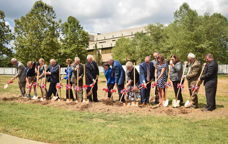 Linda+Bennett%2C+donors+and+student+ambassadors+break+ground+on+the+Fuquay+Welcome+%C3%87enter+last+Friday.+There+will+be+an+official+ribbon+cutting+ceremony+for+the+center+in+2018.