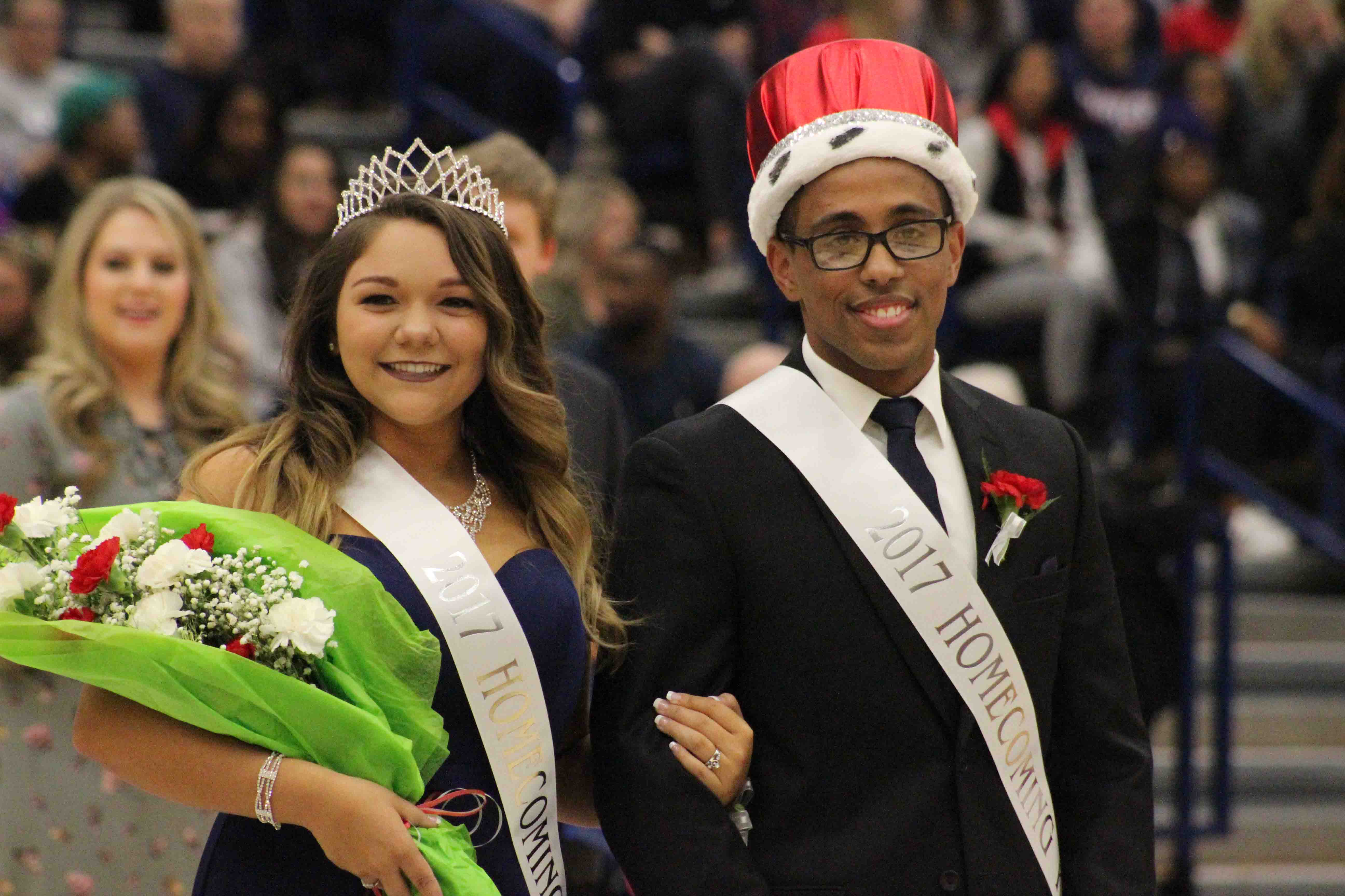 Virgilio Paulino a junior political science and philosophy major with a pre-law minor stands with Angela DaCosta, a junior biology (pre-medicine) major after they won Homecoming King and Queen Saturday afternoon in the PAC.
