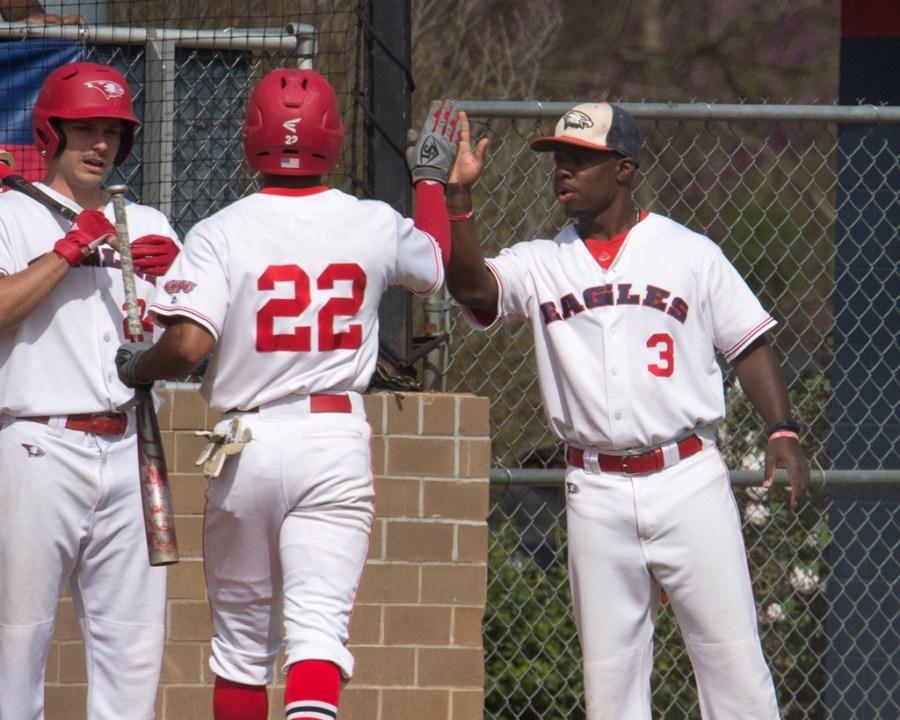 Senior+Jaylen+Quarles+gives+teammate+Buddy+Johnson+a+high-five+after+he+walks+off+the+field.+