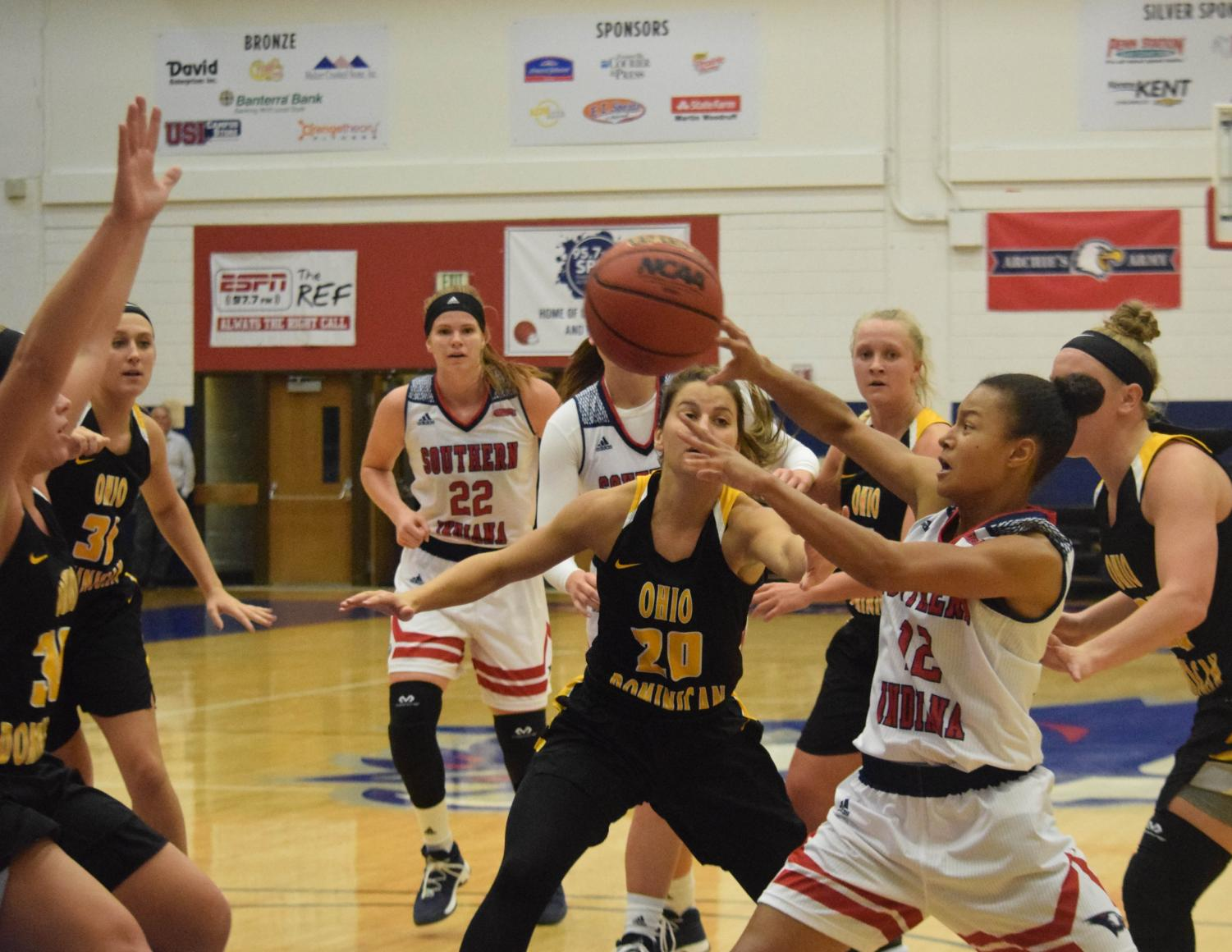 Ashley+Johnson%2C+sophomore+guard%2C+kicks+the+ball+out+to+a+teammate.