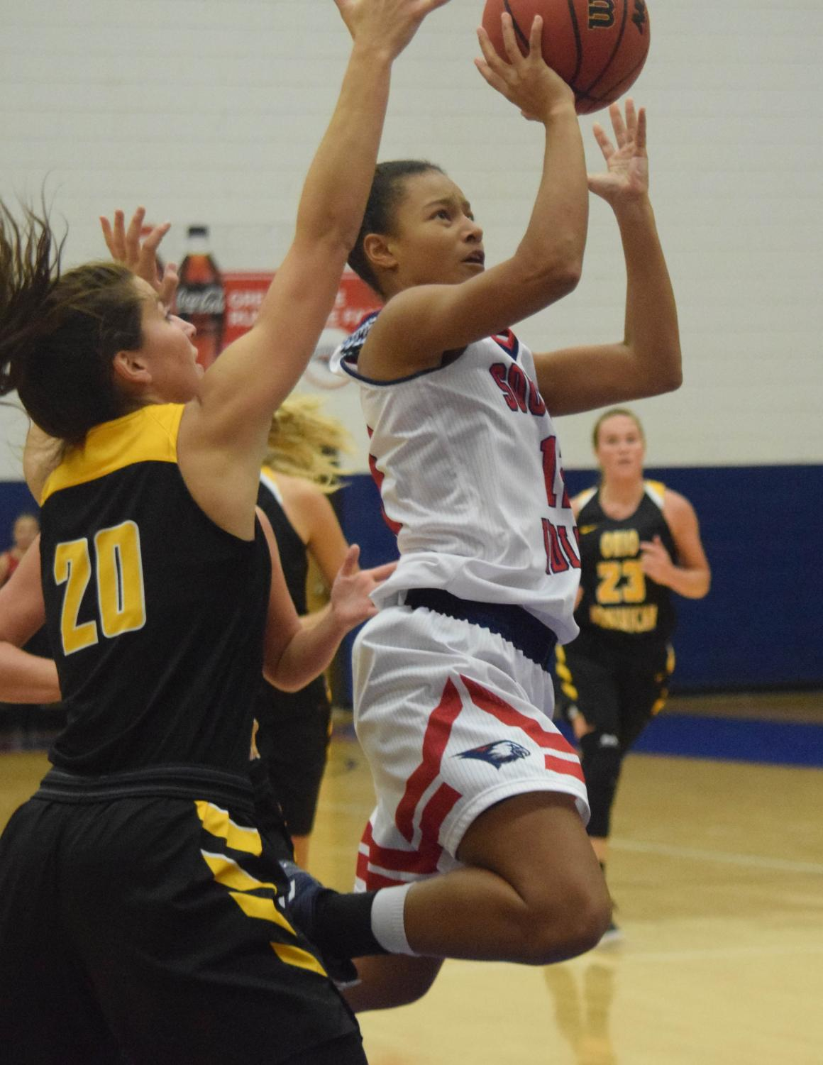 Ashley+Johnson%2C+sophomore+guard%2C+drives+to+the+basket+for+a+layup.