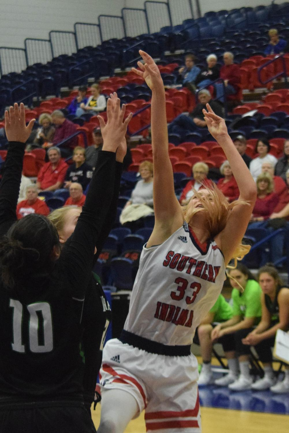 Kaydie+Grooms%2C+senior+guard%2C+shoots+the+ball+over+a+Parkside+player