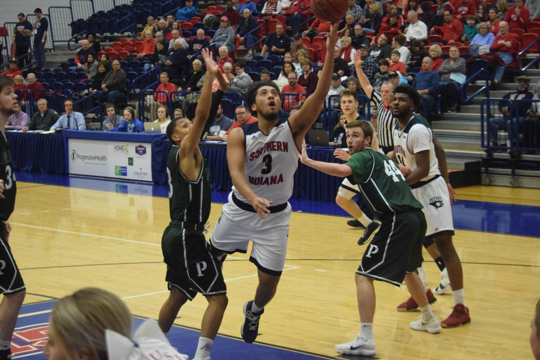Mateo+Rivera%2C+freshman+guard%2C+gets+to+the+basket+for+a+layup.