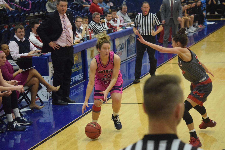 Emma+DeHart%2C+freshman+guard%2C+looks+to+pass+the+ball+inside.