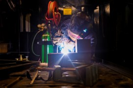 160114-N-NX690-023 ARABIAN GULF (Jan. 14, 2016) Hull Maintenance Technician 2nd Class J. Washington fabricates a grease trap in the machinery repair shop aboard aircraft carrier USS Harry S. Truman (CVN 75). Harry S. Truman Carrier Strike Group is deployed in support of Operation Inherent Resolve, maritime security operations and theater security cooperation efforts in the U.S. 5th Fleet area of operations. (U.S. Navy photo by Mass Communication Specialist 3rd Class J. M. Tolbert/Released)