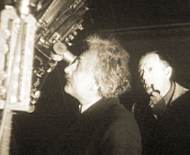 Einstein in 1931 staring at a wee bit of the universe, with Edwin Hubble