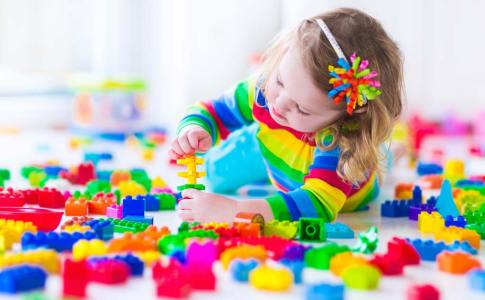 bigstock-Little-Girl-Playing-With-Color-116938994
