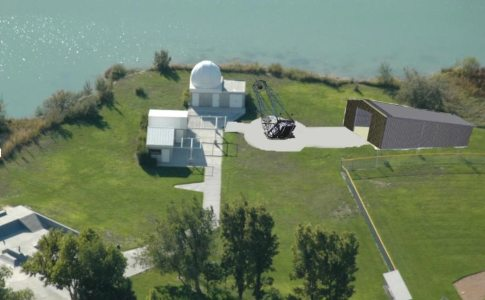 An artist's rendering of the Clements telescope, center, and its new building, right.