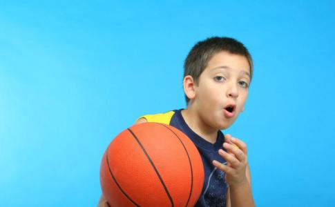 boy-playing-basketball-blue-background[1]