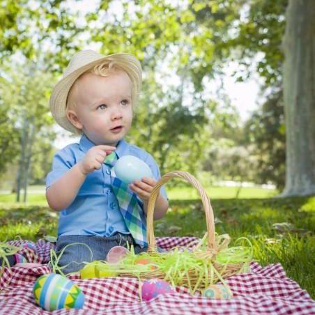 cute-little-boy-enjoying-his-easter-eggs-outside-in-park[1]