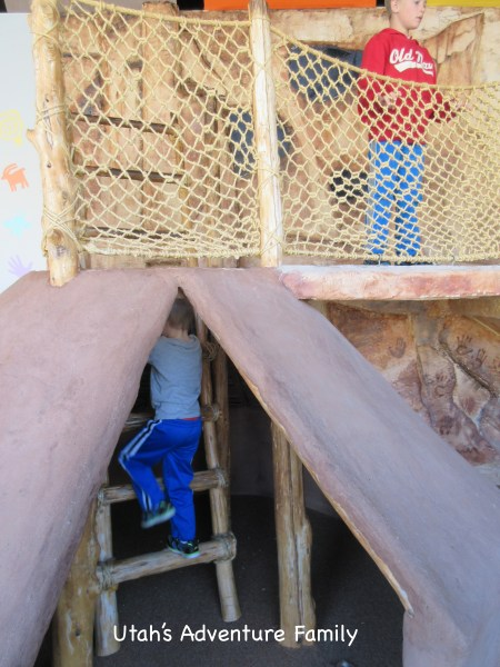 Their is a pit house that the children can play and climb in.