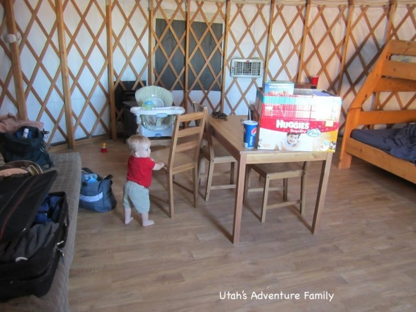 Inside the yurt: futon on the left, bunk bed on the right, swamp cooler and heater in the back.