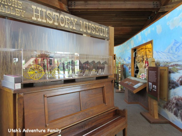 This tiny museum fills the space behind this piano.