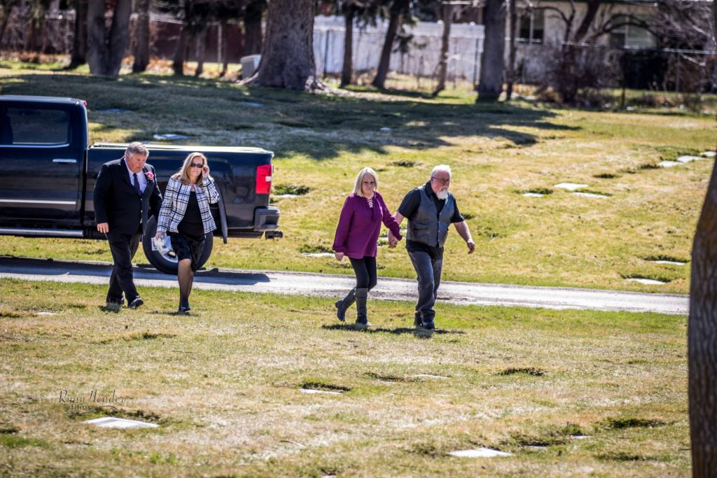 FAMILY WALKING TO CEMETARY Wasatch lawn salt lake city cemetery photography for funerals Ryan hender films