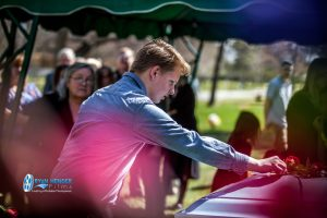 grandson placing rose on casket funeral service salt lake city utah Ryan hender photography
