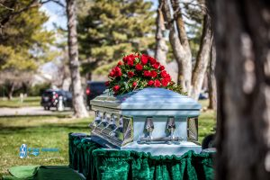 casket at graveside with flroal spray Ryan hender photography
