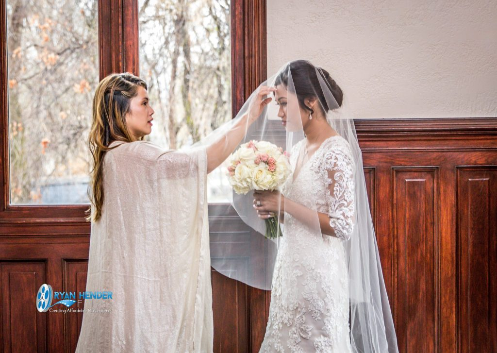 bride and maid of honor before wedding ceremony