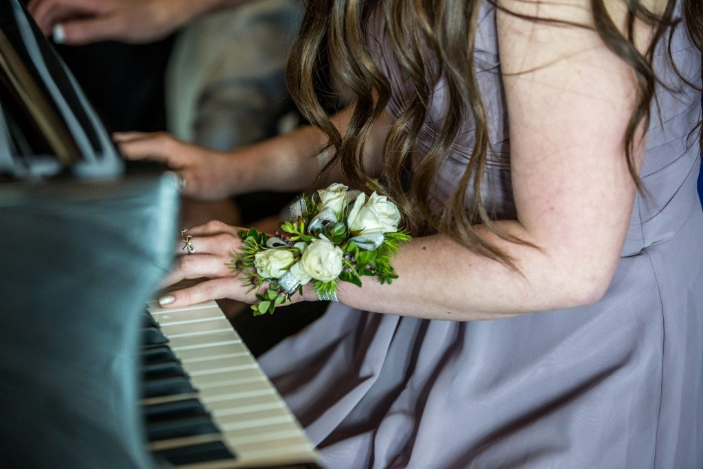 sister playing piano wadley farms castle wedding venue