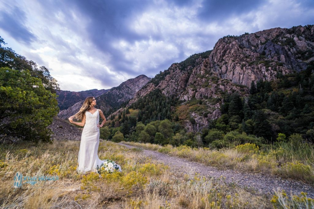 bride in dress in mountains bridal photo shoot