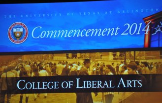 A large video screen at the May 2014 College of Liberal Arts Commencement ceremony May 9, 2014, at the College Park Center. (Photo by James Dunning)