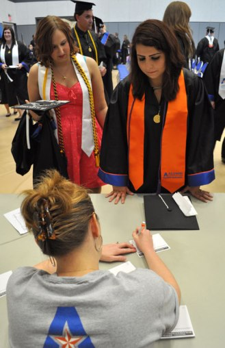 Students check in before the May 2014 College of Liberal Arts Commencement ceremony May 9, 2014, at the College Park Center. (Photo by James Dunning)