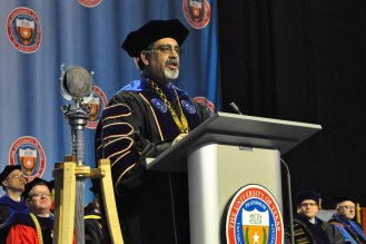 UTA President Vistasp Karbhari speaks to students at the College of Liberal Arts' December 2014 commencement Friday, Dec. 12, at the College Park Center. (Photo by James Dunning/COLA Communications)