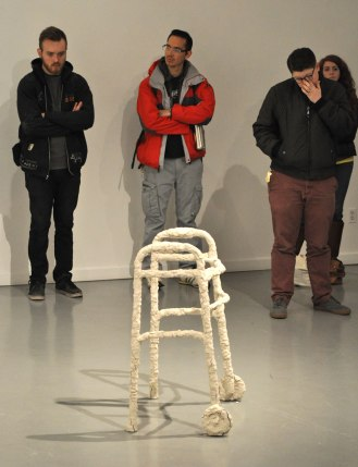 """Visitors examine Pierre Krause's """"ME BODIED"""" in The Gallery at UTA's latest exhibition, """"Subject: Disability."""" (Photo by James Dunning/COLA Communications)"""