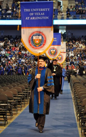 Assistant Dean Eric Bolsterli leads the procession Friday, May 15, during the College of Liberal Arts' Spring 2015 Commencement at College Park Center. (Photo by James Dunning/COLA Communications)
