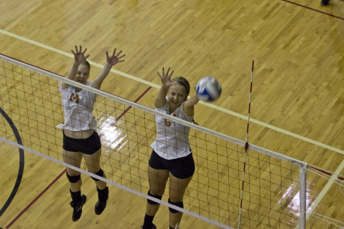 Marcelo Yates| Staff Photographer Senior middle blocker Taylour Toso (right) and freshman middle blocker Emma Wallbrown (left) go up to block the ball as it comes over the net at the Labor Day tournament on Aug. 29 and 30. The team was tabbed to finish second in the ASC, according to the league's preseason poll.