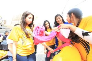 Yang Xi|Staff Gurbani Makkar, president of the Sikh Student Association helps tie a turban at Tie a Turban Day.