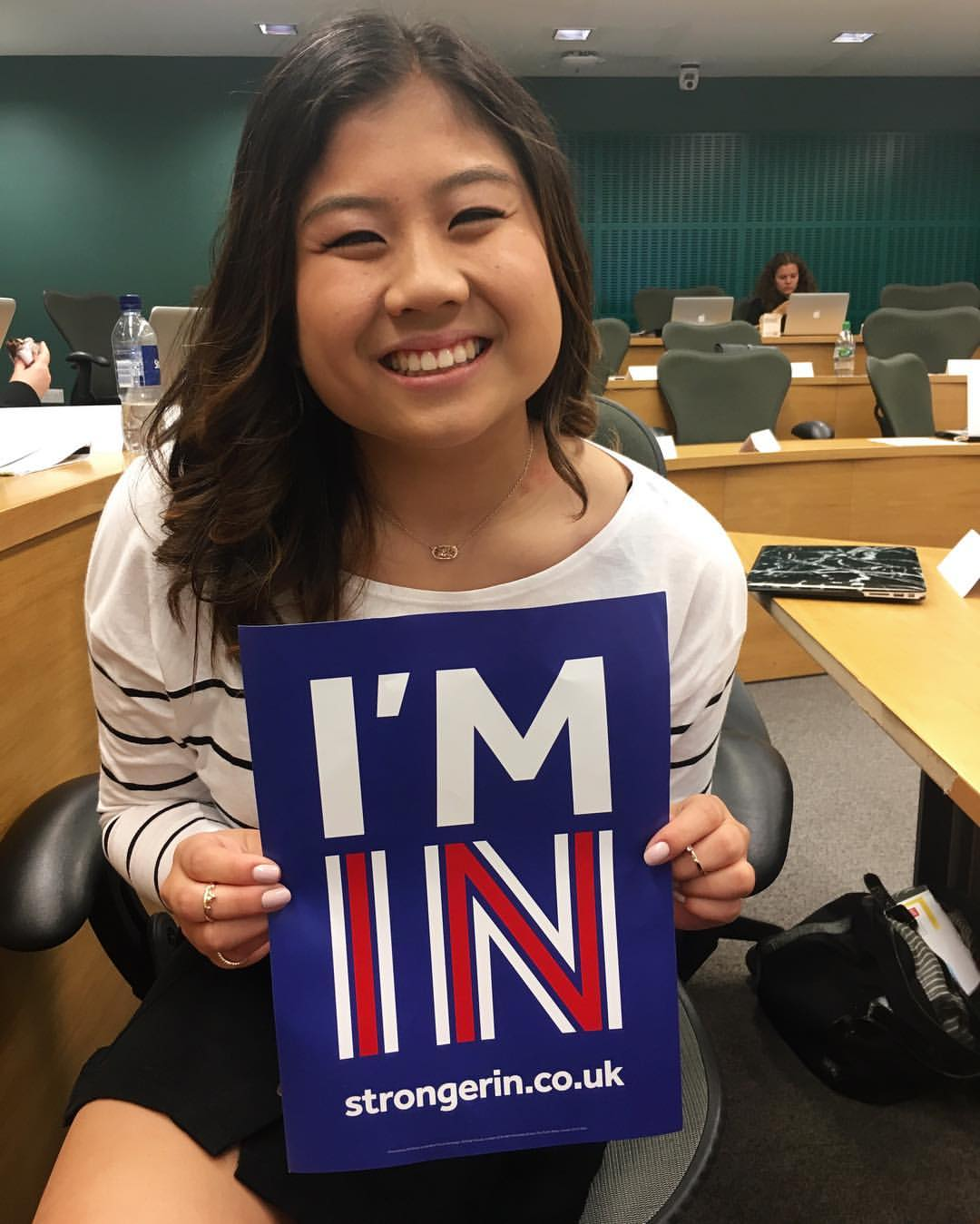 Rebecca Tjahja holds a sign supporting the U.K. staying in the European Union. The finance junior was studying abroad at the London School of Economics during the June 23 referendum. Photo courtesy of Rebecca Tjahja.