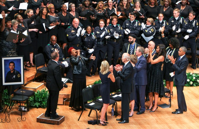 Current and former leaders of the United States stand as the choir commemorates the fallen officers and those impacted by the shooting in downtown Dallas.