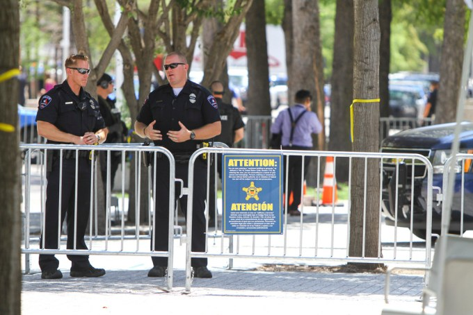 Police officers work to secure the area around the Morton H. Meyerson Symphony Center in preparation for the arrival of the President of the United States.
