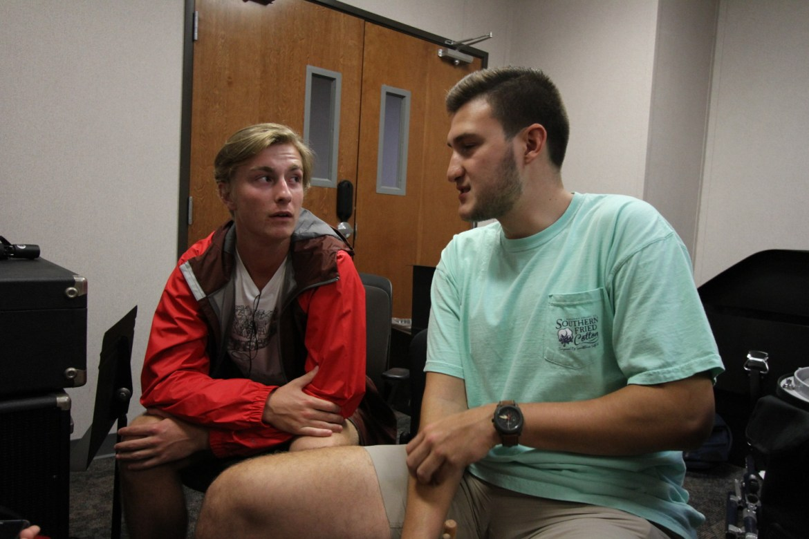 Political science sophomore Jacob Munoz (right) and global business freshman Andrew Alston await their turn to try out for the quints. Photo by Yash Musalgaonkar | Mercury Staff.