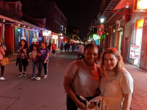 Brianna Kelly and Abigail Nelson on Canal Street in New Orleans during NCHC.