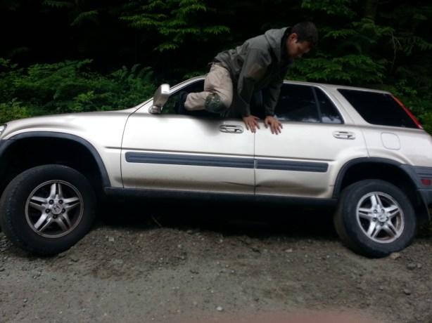 A man A car A ditch